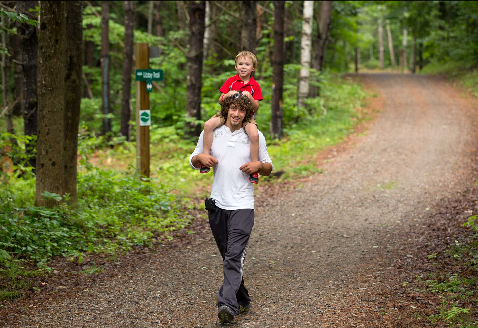 Father and Son  on a hike for the cover of the MaineHealth Community Benefit Report