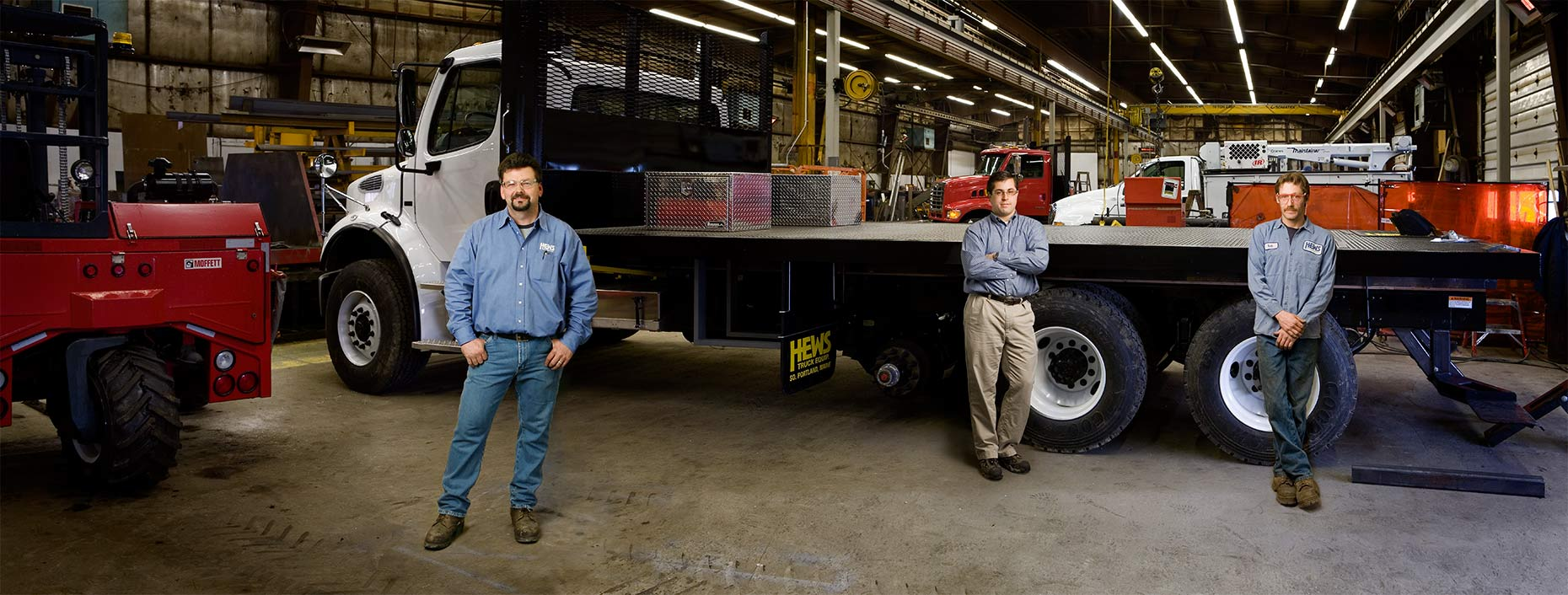 Group panoramic photo of workers at Truck customization firm by commercial photographer Kevin Brusie
